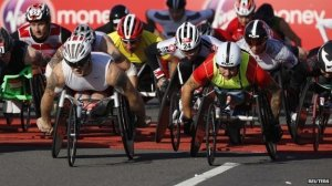 Paralympians and previous winners Josh Cassidy and David Weir lead the men's field at the start of the 2014 London Marathon. Reuters