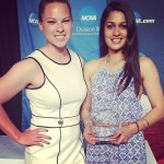 Divya Biswal with her NCAA Atlantic Region Field Performer of the Year Award and coach Kelly Curtis (l)